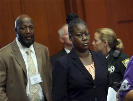 Trayvon Martin's parents Tracy Martin and Sybrina Fulton enter the courtroom after a morning recess in George Zimmerman secondnd-degree murder trial in the fatal shooting of Trayvon Martin in Seminole circuit court in Sanford