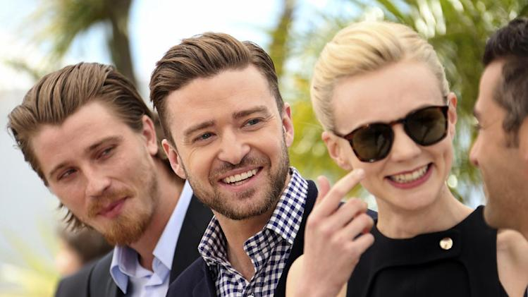 From left, actors Garrett Hedlund, Justin Timberlake, Carey Mulligan and Oscar Isaac pose for photographers during a photo call for the film Inside Llewyn Davis at the 66th international film festival, in Cannes, southern France, Sunday, May 19, 2013. (Photo by Joel Ryan/Invision/AP)