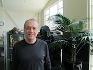 "In this Nov. 14,2012 photo, Weta Digital director Joe Letteri stands in the offices of the company's Wellington studios in New Zealand. Weta Digital is the centerpiece of a filmmaking empire that Peter Jackson and close collaborators have built in his New Zealand hometown, realizing his dream of bringing a slice of Hollywood to Wellington. It's a one-stop shop for making major movies - not only his own, but other blockbusters like ""Avatar"" and ""The Avengers"" and hoped-for blockbusters like next year's ""Man of Steel."" (AP Photo/Nick Perry)"