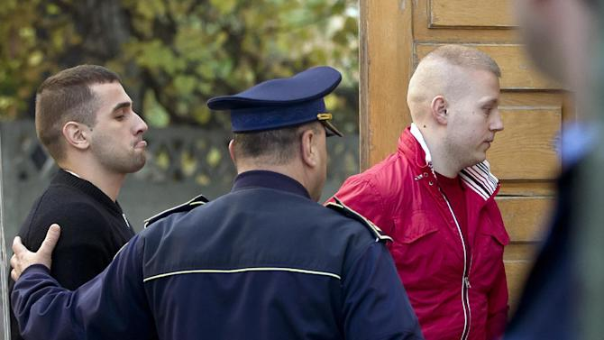 Eugen Darie, right, and Alexandru Bitu, left, two suspects charged with stealing paintings from a Dutch museum, enter a court building for a hearing in their trial in Bucharest, Romania, Tuesday, Oct. 22, 2013. Three Romanians have pleaded guilty to stealing seven paintings, including works by Picasso, Monet and Matisse, from a Dutch museum in a daring daytime raid that shocked the art world. The suspects, Bitu Darie and Radu Dogaru, told the court that they took the multimillion-dollar paintings from Kunsthal Museum in October 2012.(AP Photo/Vadim Ghirda)