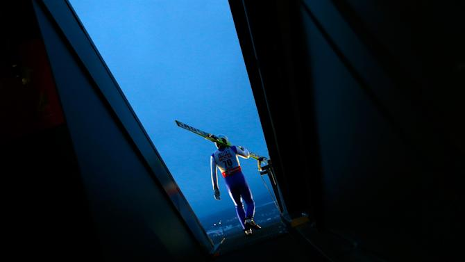 Ito of Japan arrives for a training jump in the men's large hill team ski jumping event at the Nordic World Ski Championships in Falun