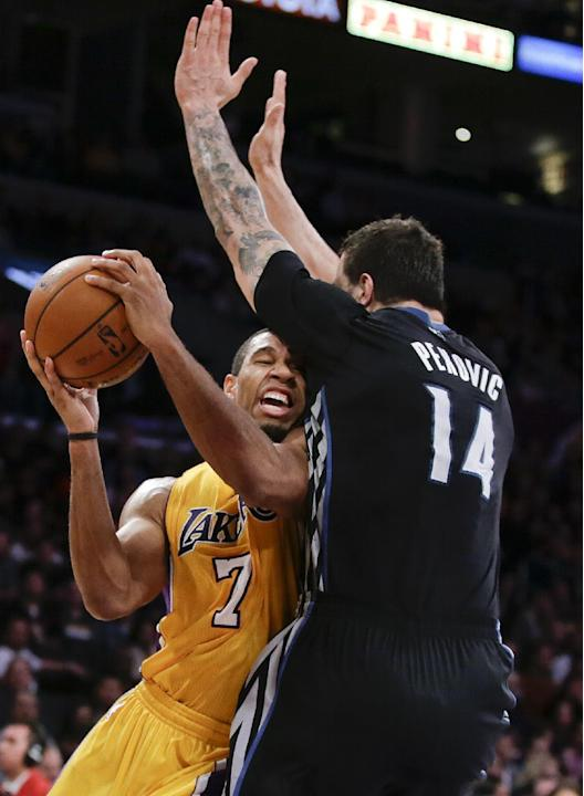 Minnesota Timberwolves center Nikola Pekovic, right, blocks Los Angeles Lakers forward Xavier Henry's route to the basket during the first half of an NBA basketball game in Los Angeles, Friday, De