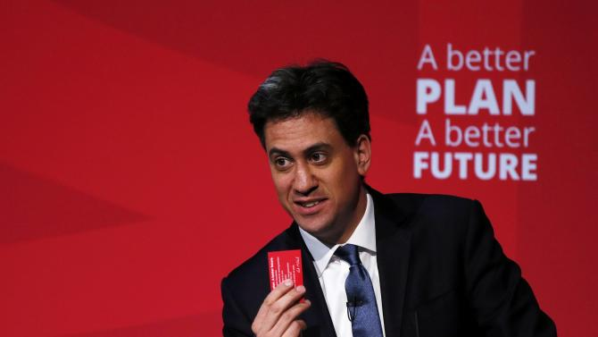 Britain's opposition Labour Party leader Ed Miliband holds up a pledge card during a speach at an election campaign event in Stockton-on -Tees in northern England