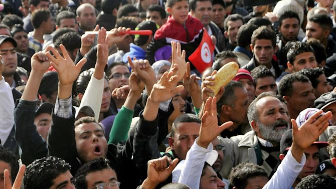 Demonstrators protest against the visit of Tunisian President Moncef Marzouki, Monday, Dec. 17, 2012, in Sidi Bouzid, south Tunisia, the birthplace of the country's recent revolution. Marzouki arrived to mark the revolution's second anniversary. (AP Photo/Hichem Borni)