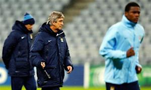 Manchester City's manager Pellegrini conducts a training session in Munich