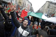 Thousands of demonstrators march shouting slogans during a protest against high utility bills and monopolies in the energy sector in Sofia February 24, 2013. Tens of thousands of Bulgarians marched through cities across the Balkan country on Sunday, protesting against high utility prices and energy monopolies and demanding sweeping political changes. Public anger with high power bills in the European Union&#39;s poorest member state forced the rightist government of Boiko Borisov to resign, but the move failed to calm down people, fed up with low living standards and rampant corruption. REUTERS/Stoyan Nenov (BULGARIA - Tags: POLITICS CIVIL UNREST BUSINESS ENERGY)