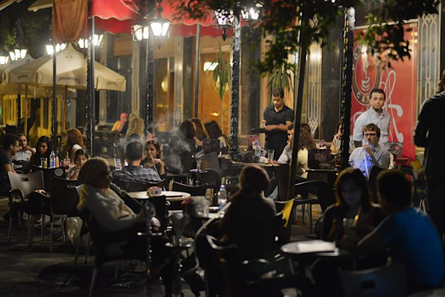 Egyptians relax outside a cafe in Cairo, Egypt, Wednesday, Oct. 31, 2012. Egypts capital prides itself on being city that never sleeps, with crowds filling cafes and shops open into the small hours. So the government is facing a backlash from businesses and the public as it vows to impose new nationwide rules closing stores and restaurants early. Officials say the crisis-ridden nation has to conserve electricity, but they also seem intent on taming a population they see as too unruly. (AP Photo)