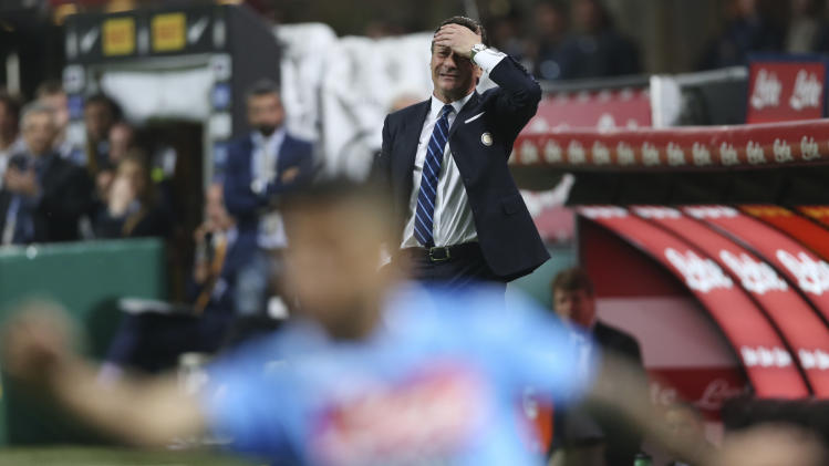 Inter Milan coach Walter Mazzarri touches his head reacting during a Serie A soccer match between Inter Milan and Napoli, at the San Siro stadium in Milan, Italy, Saturday, April 26, 2014. (AP Photo/Luca Bruno)