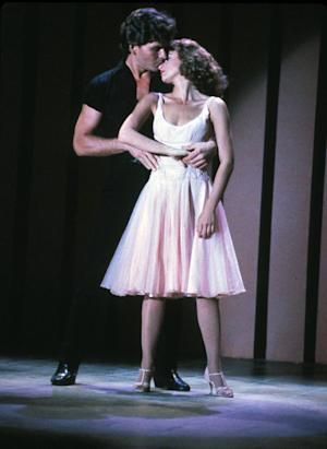 """FILE - In this image provided by Lionsgate Home Entertainment, Patrick Swayze, portraying Johnny Castle, and Jennifer Grey, portraying Baby Houseman, are shown in a scene from the film, """"Dirty Dancing."""" Lionsgate is set to produce a remake of the film directed by Kenny Ortega. (AP Photo/Lionsgate Home Entertainment)"""