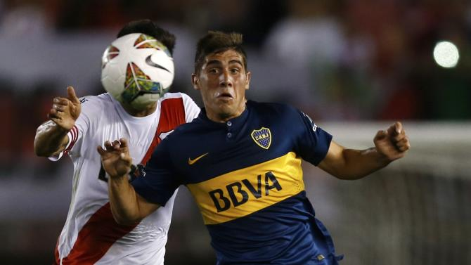 River Plate's Gutierrez and Boca Juniors' Erbes fight for the ball during their Copa Sudamericana second leg semi-final soccer match in Buenos Aires