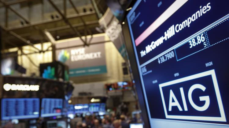 File photo of the American International Group, Inc. (AIG) stock ticker on a monitor as traders work on the floor of the New York Stock Exchange