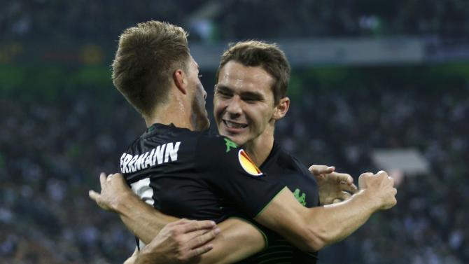 Borussia Moenchengladbach's Herrmann celebrates with Hrgota after scoring against Villareal during Europa League soccer match in Muenchengladbach