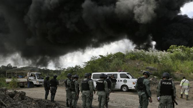 Police officers guard the incineration of confiscated drugs in Panama City