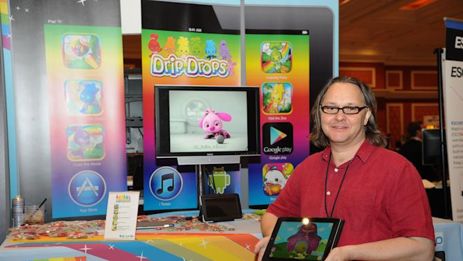 IMAGE DISTRIBUTED FOR DRIP DROPS - App creator, Ian Morrison, seen at CES Showstoppers, on Tuesday, Jan. 8, 2013, in Las Vegas, Nevada, Drip Drops debuts Color the World app turning a tablet into a 3d digital coloring book for preschoolers. (Photo by Al Powers/Invision for Drip Drops/AP Images)