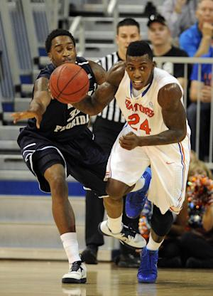 No. 10 Florida holds on for 77-69 win over UNF