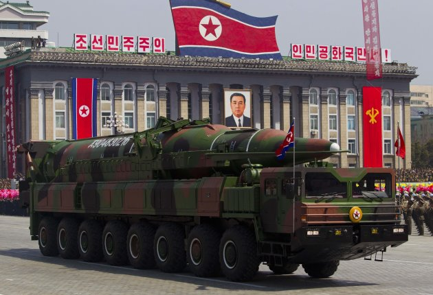 FILE - In this April 15, 2012 file photo, a North Korean vehicle carrying a missile passes by during a mass military parade in Pyongyang's Kim Il Sung Square to celebrate the centenary of the birth of the late North Korean founder Kim Il Sung. Japan has evidence that vehicles capable of transporting and launching missiles were exported to North Korea by a Chinese company in possible violation of U.N. sanctions, Japanese media reported Wednesday, June 13, 2012. China called the reports inaccurate, and denied violating any U.N. restriction. (AP Photo/David Guttenfelder, File)