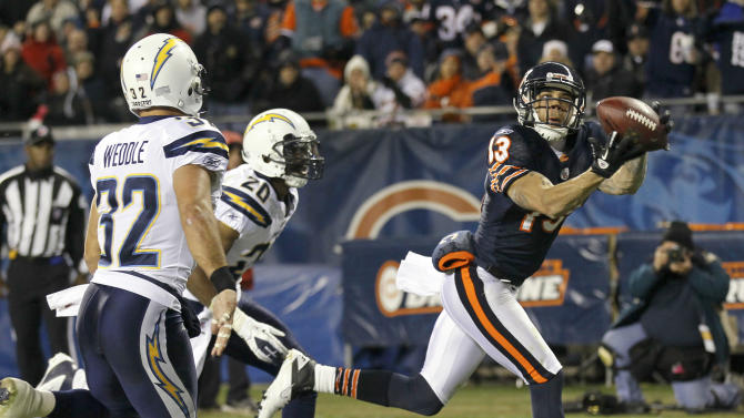 Chicago Bears wide receiver Johnny Knox (13) makes a 24-yard touchdown reception in front of San Diego Chargers safety Eric Weddle (32) and cornerback Antoine Cason (20) in the second half of an NFL football game in Chicago, Sunday, Nov. 20, 2011. (AP Photo/Charles Rex Arbogast)