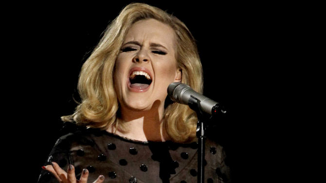 """FILE - In this Feb. 12, 2012 file photo, Adele performs during the 54th annual Grammy Awards in Los Angeles. The British singer's """"21"""" was the highest-selling album in the U.S. for the second consecutive year, according to 2012 sales figures released by Nielsen SoundScan on Thursday, Jan. 3, 2013. That's a first in the SoundScan era. (AP Photo/Matt Sayles, File)"""
