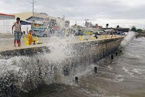 Waves, brought by Typhoon Hagupit, hit the concrete barrier along the Boulevard Seaport in Surigao City