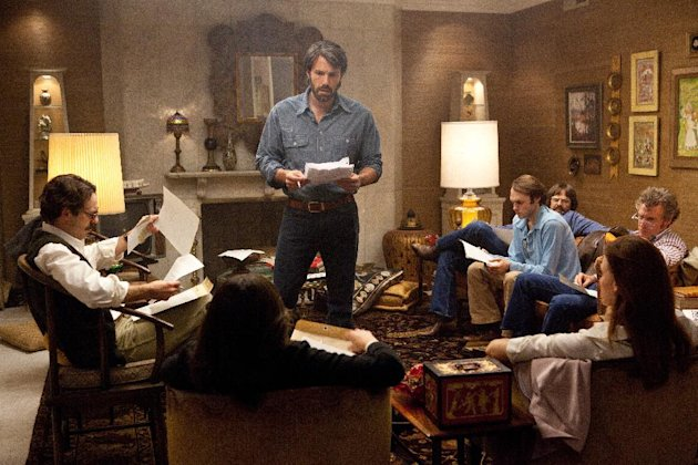 "This film image released by Warner Bros. Pictures shows Ben Affleck as Tony Mendez, center, in ""Argo,"" a rescue thriller about the 1979 Iranian hostage crisis. The film will be presented at the 37th Toronto International Film festival running through Sept. 16. (AP Photo/Warner Bros., Claire Folger)"