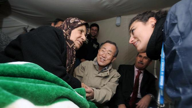 U.N. chief Ban Ki-moon, center, visits Syrian refugees at a camp in Islahiye, near the Syrian border, Turkey, Friday, Dec. 7, 2012. Ban will also meet Turkish officials in Ankara Friday for talks on the Syrian civil war.(AP Photo/Veli Gurgah, Pool)
