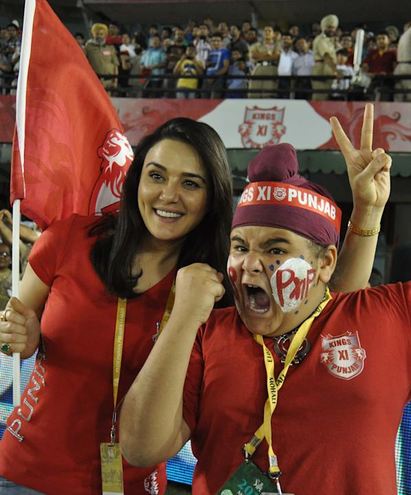 KXIP co-owner Preity Zinta celebrate with fans after winning the match between Kings XI Punjab and Pune Warriors India at Punjab Cricket Association Stadium, Mohali on April 21, 2013. (Photo: IANS)
