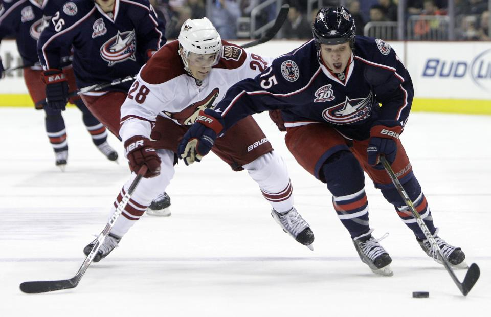 Columbus Blue Jackets' Derek Dorsett, right, and Phoenix Coyotes' Lauri Korpikoski, of Finland, chase a loose puck during the second period of an NHL hockey game Friday, Feb. 25, 2011, in Columbus, Ohio. (AP Photo/Jay LaPrete)