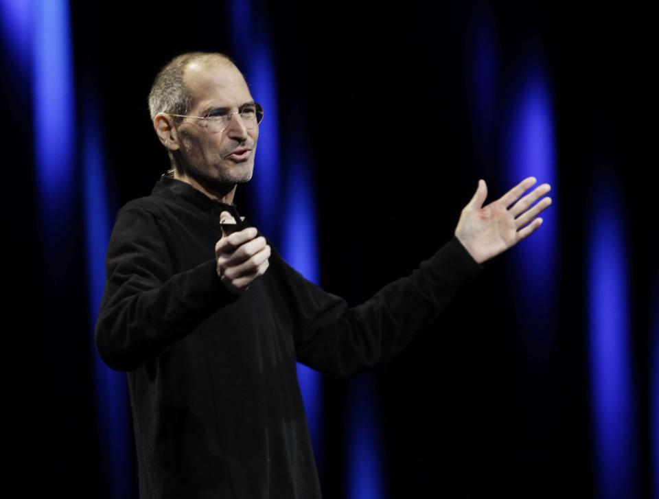 Apple CEO Steve Jobs gestures to his audience during a keynote address to the Apple Worldwide Developers Conference in San Francisco, Monday, June 6, 2011.  (AP Photo/Paul Sakuma)