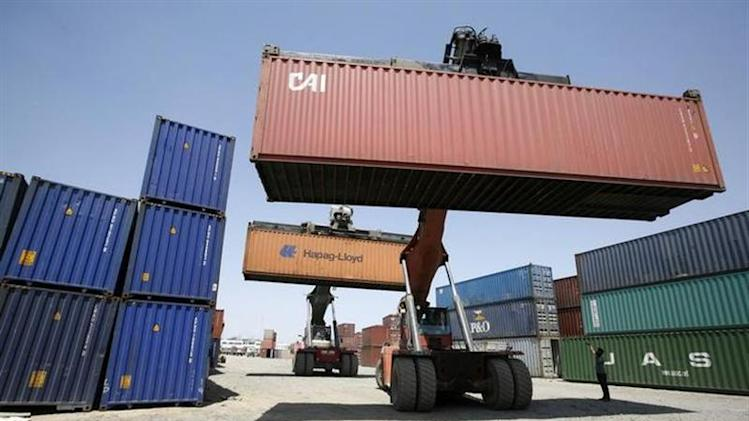 Mobile cranes prepare to stack containers at Thar Dry Port in Sanand in Gujarat May 2, 2011. REUTERS/Amit Dave/Files