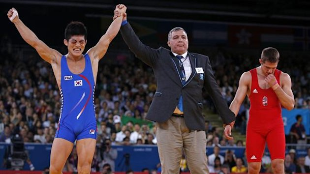 South Korea's Hyeonwoo Kim celebrates his victory after defeating Hungary's Tamas Lorincz on the final of the Men's 66Kg Greco-Roman wrestling at the ExCel venue during the London 2012 Olympic Games August 7, 2012.