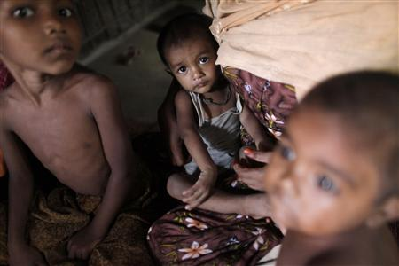 Rohingya children, who fled the recent violence of Myanmar, sit in a house as they hide with other relatives in Teknaf October 30, 2012. REUTERS/Andrew Biraj