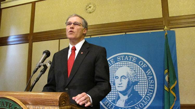 Gov. Jay Inslee announces Tuesday, Feb. 11, 2014, that he is suspending the use of the death penalty in Washington state during a news conference in Olympia, Wash. Inslee's moratorium, which will be in place for as long as he is governor, means that if a death penalty case comes to his desk, he will issue a reprieve, which isn't a pardon and doesn't commute the sentences of those condemned to death. (AP Photo/Rachel La Corte)