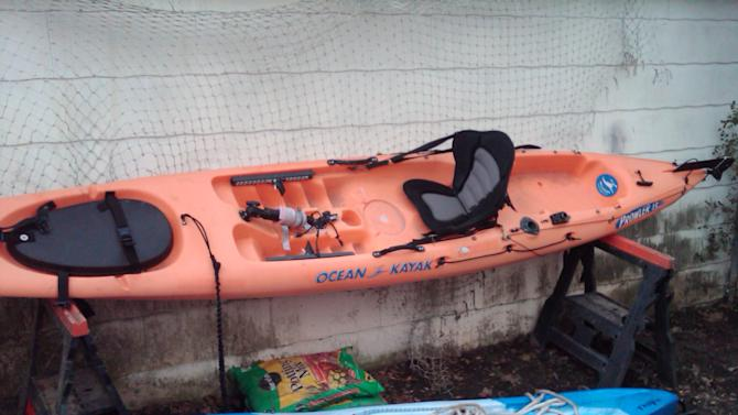 Two of the kayaks used by residents to evacuate women, children and older people at the height of Superstorm Sandy are seen Friday Nov. 2, 2012. Residents in Belle Harbor, Queens, commenced the evacuation at the storm's peak after a fire that destroyed 14 homes on their street threatened their own. (AP Photo/Lawrence Neumeister)