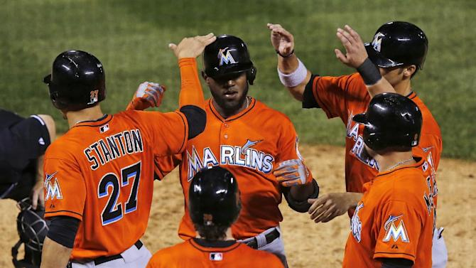 Ozuna's slam helps Marlins beat Rockies 13-5
