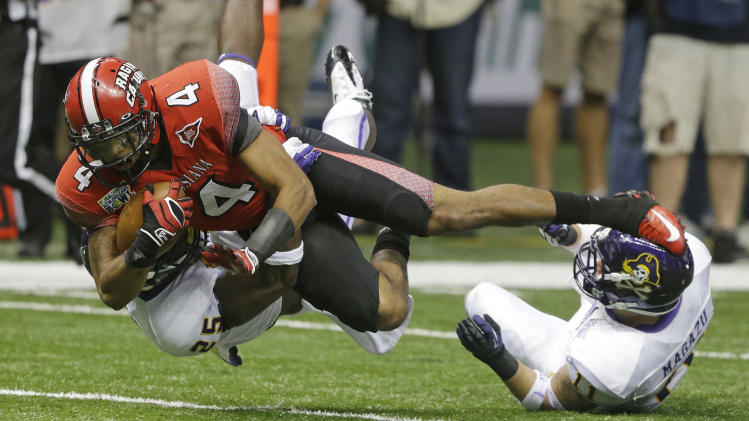 Louisiana-Lafayette wide receiver Javone Lawson (4) is taken down by East Carolina defensive back Leonard Paulk (25) and  defensive back Damon Magazu (11) in the first half of the New Orleans Bowl, an NCAA college football game in New Orleans, Saturday, Dec. 22, 2012. (AP Photo/Bill Haber)