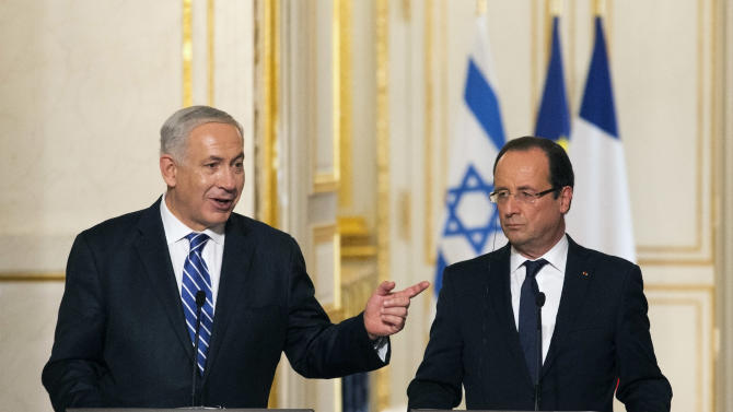 Israeli Prime Minister Benjamin Netanyahu, left, speaks during a joint news conference with French President Francois Hollande following their meeting at the Elysee Palace, Paris, Wednesday, Oct. 31, 2012. Netanyahu is visiting France on Wednesday and Thursday and will pay homage to a rabbi and three Jewish schoolchildren killed in France's worst terrorist attack and worst anti-Semitic attack in years. (AP Photo/Jacques Brinon)