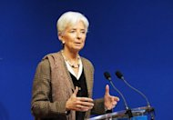 The United States needs to raise taxes and cut spending to address the looming fiscal cliff, IMF chief Christine Lagarde, pictured in November 2012, said Sunday, warning that anything less would undermine economic confidence.