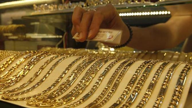 Gold chains are displayed for sale at a shop in Hanoi June 5, 2013. REUTERS/Kham/Files