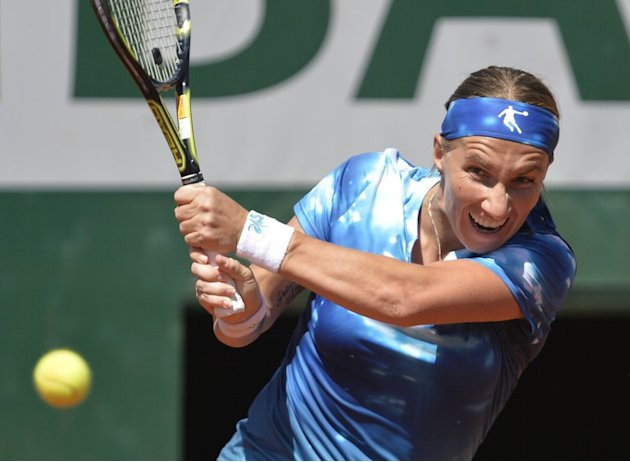 Svetlana Kuznetsova makes a return to Serena Williams in a French Tennis Open clash at Roland Garros on June 4, 2013