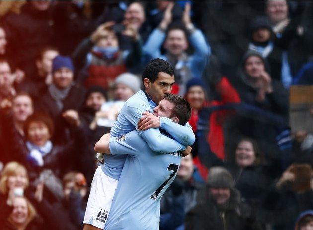 Manchester City's Tevez celebrates his goal against Chelsea with Milner during their English Premier League soccer match in Manchester