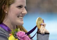 United States' Missy Franklin poses with her gold medal in the women's 200-meter backstroke final during the men's 50-meter freestyle final at the Aquatics Centre in the Olympic Park during the 2012 Summer Olympics in London, Friday, Aug. 3, 2012. (AP Photo/Mark J. Terrill)