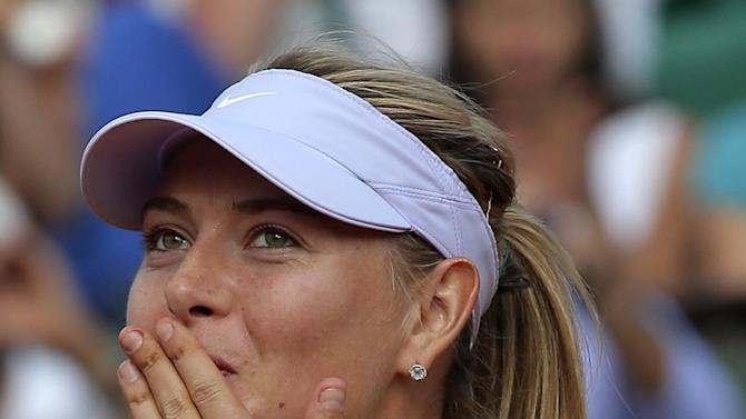 Russia's Maria Sharapova blows a kiss to the public after defeating Victoria Azarenka of Belarus in three sets 6-1, 2-6, 6-4, in their semifinal match at the French Open tennis tournament, at Roland Garros stadium in Paris, Thursday June 6, 2013. (AP Photo/Michel Euler)