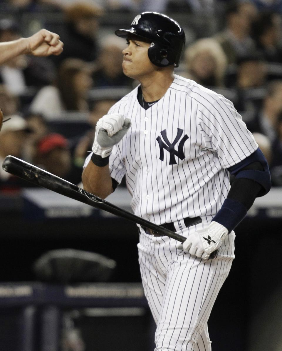 New York Yankees' Alex Rodriguez reacts after striking out during the fourth inning of Game 3 of the American League division baseball series against the Baltimore Orioles on Wednesday, Oct. 10, 2012, in New York. (AP Photo/Kathy Willens)