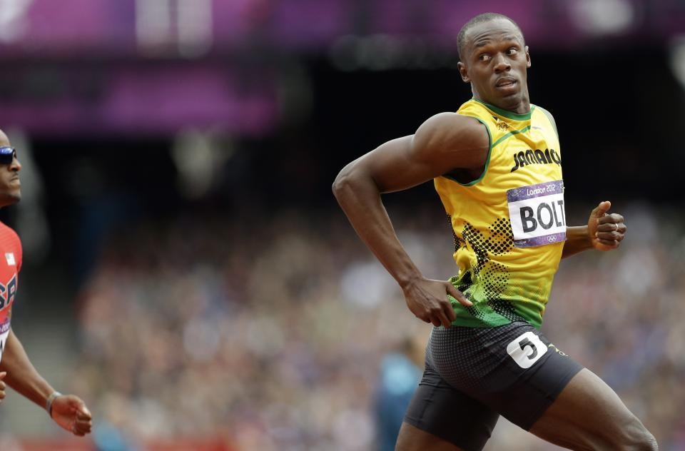 Jamaica's Usain Bolt competes in a men's 200-meter heat during the athletics in the Olympic Stadium at the 2012 Summer Olympics, London, Tuesday, Aug. 7, 2012. (AP Photo/Lee Jin-man)