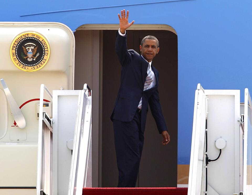 President Barack Obama waves as he boards Air Force One before departing to Colorado, Friday, June 29, 2012, at Andrews Air Force Base, Md. (AP Photo/Jose Luis Magana)