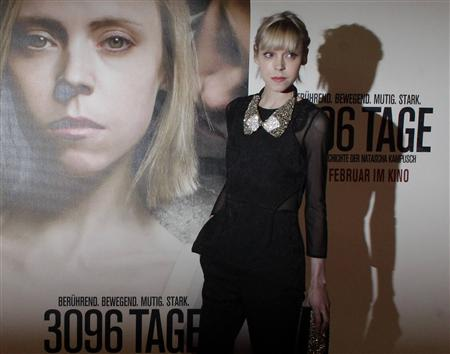 "Actress Antonia Campbell-Hughes poses in front of a film poster before the premiere of the film ""3,096 Days"" in a cinema in Vienna February 25, 2013. REUTERS/Herwig Prammer"