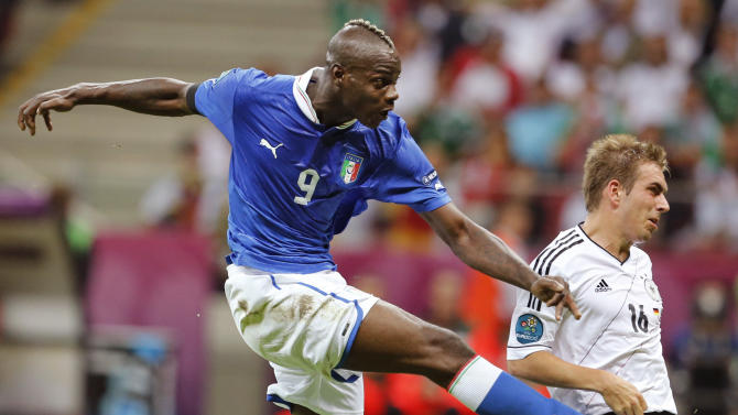 Italy's Mario Balotelli scores his team's second goal by Germany's Philipp Lahm during the Euro 2012 soccer championship semifinal match between Germany and Italy in Warsaw, Poland, Thursday, June 28, 2012. (AP Photo/Gregorio Borgia)