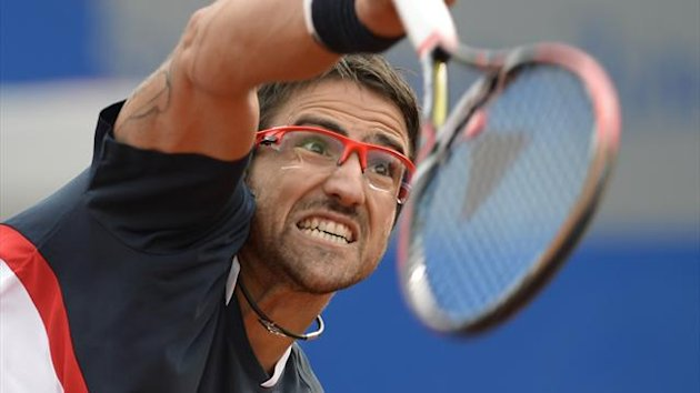 Serbian Janko Tipsarevic serves the ball during his ATP tennis BMW Open second round match against Slovenian Grega Zemlja in Munich, southern Germany, on May 2, 2013 (AFP)
