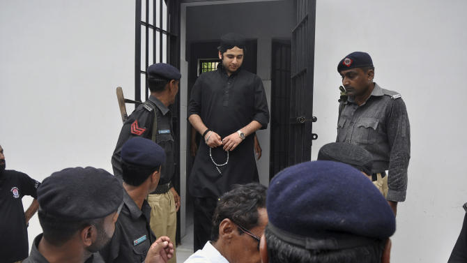 Shahrukh Jatoi, top center, convicted of killing 20-year-old Shahzeb Khan, is escorted by members of the police to an Anti-Terrorism court in Karachi, Pakistan, Friday, June 7, 2013. Jatoi and Nawab Siraj Talpur received death sentences Friday over a fatal shooting that exposed class divisions in Pakistan and led to an unusual social media campaign demanding that the country's rich and powerful be held accountable. (AP Photo/Shakil Adil)