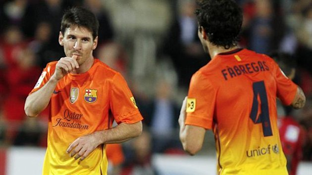 Lionel Messi celebrates scoring against Mallorca, November 2012